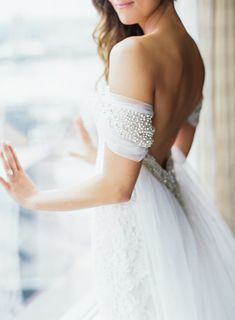 Gorgeous pearl off-the-shoulder wedding dress detail: Photography : Carla Gates Photography Read More on SMP: http://www.stylemepretty.com/2016/02/12/elegant-romantic-atlanta-spring-wedding/