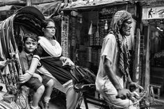 Bangladeshi lady with her child riding a rickshaw, Hindu Street/Shankaria Bazaar, Dhaka, Bangladesh