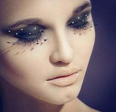 Crystal accented smokey eye make-up with statement eye lashes,