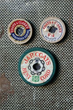 Magnets from the tops of old wooden spools of thread.  Love these and bought tons of old thread at rummages this summer :)