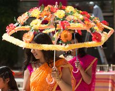 Inspired by the vibrant South Asian wedding wedding palettes, these are great for bridal party entrances.Good idea for an umbrella over table Decoration Evenementielle, Marriage Decoration, Indian Wedding Decorations, Flower Decorations, Umbrella Decorations, Desi Wedding, Wedding Events, Indian Wedding Stage, Wedding Dinner