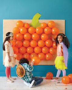 Confetti- and candy-filled balloons turn this giant pumpkin wall decor into a…
