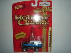 2011 Johnny Lightning Holiday Classic 1977 International Scout II Silver/White/Blue by Learning Curve. $19.99. 1:64. Gripclip Included to Transform Car into Xmas Ornament. Rubber Tires