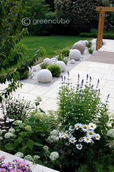 Clean and Modern Stone Gravel Planted Beds. Green and white garden...