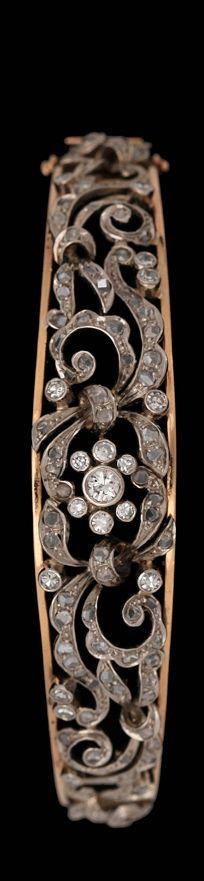 A brilliant- and rose cut diamond bangle.  18k gold