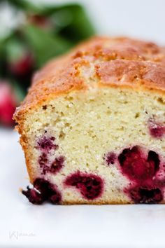 Welcome spring and warmer weather with this delicious and moist raspberry lemon pound cake, topped with a raspberry tea-infused glaze.