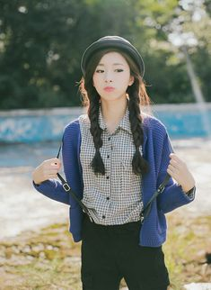 I really like the black and white grid top with the blue cardigan, but to fit more of my style I would have one side braid instead of two.