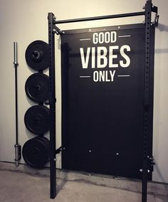 """Read it and live it. """"Good vibes only"""" in this garage gym!"""