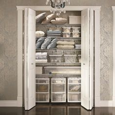 A well-organized hall closet. We love the drawers at the bottom!