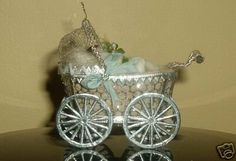 """Sebnitz Baby Carriage w/ wax baby and dresden wheels and trim, wire mesh, silk, and glass beads. By Betsy Browning see """"about me"""" page for more information"""