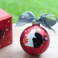 Newlywed fans will love this UGA Bride and Groom Ornament. Personalize it with a couples's name and wedding date for a special spirited keepsake. All collegiate ornaments come boxed and tied with a coordinating ribbon making them the perfect gift for anyone.