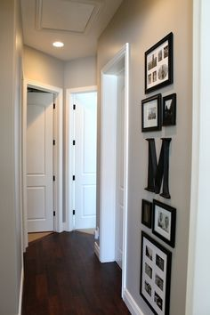 """I chose this hallway because I like how the picture frames were used as well as the letter """"M."""" The pictures give the place a friendly and family oriented feel to it. Gives it a home feeling to the space. You get to know someone better as well."""