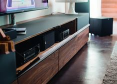 High-end Cubus media unit cabinets shown in charcoal black glass and walnut Media Furniture, Living Room Furniture, Living Room Decor, Tv Stand Decor, Living Room Tv Unit Designs, Rack Tv, Tv Wand, Tv Wall Decor, Tv Wall Design