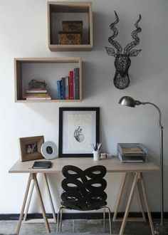 small home office with box shelves and a cool chair