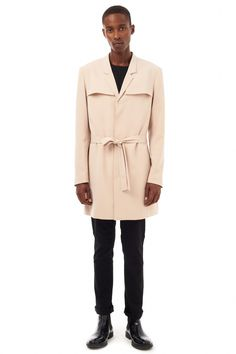 Pairing a beige trenchcoat with black pants is an on-point option for a day in the office. Black leather chelsea boots will add elegance to an otherwise simple look.   Shop this look on Lookastic: https://lookastic.com/men/looks/beige-trenchcoat-black-long-sleeve-t-shirt-black-chinos/17550   — Black Long Sleeve T-Shirt  — Beige Trenchcoat  — Black Chinos  — Black Leather Chelsea Boots