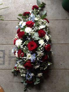 Funeral Flowers. West Ham funeral flower tribute spray, red roses, blue delphinium. www.thefloralartstudio.co.uk