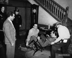 "Director Frank Capra and Cary Grant on the set of ""Arsenic and Old Lace"" (1944)."