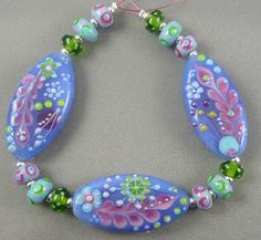 Doodles oval tab (Made to order) Lampwork bead set by Pixie Willow Designs, via Etsy.