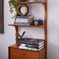http://www.westelm.com/products/mid-century-wall-shelving-narrow-h1736/?pkey=cshelf-storage