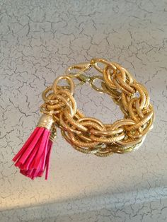 Bracelet with pink tassel - classic and preppy with a modern accent.