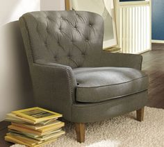 tufted grey chair.