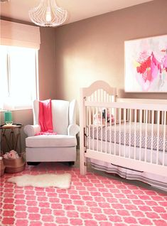 here's a modern version of a girl's nursery...dark gray on walls, coral pink on geometric carpet and modern art & lighting. All the white really helps the walls feel not too dark. How do you like the idea of a chair in there?