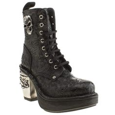 Rock on in the Vintage Flower Skull Boot from New Rock. The black leather upper is adorned in a vintage floral print and features a large skull on the side of each boot for an edgy feel. A 10cm heel and 4cm platform lets everyone know you mean business. <br><br><ul><li>Leather upper</li><li>Rubber sole unit</li><li>10cm heel & 4cm platform</li></ul>