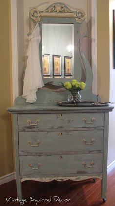 Antique dresser with mirror painted in Annie Sloan Duck Egg and Old White and washed with CoCo. #shabbychicdresserswithmirror