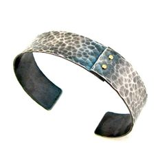 Wide hammered cuff bracelet in oxidized sterling silver with 18k gold rivets by Lisa Crowder. American Made. See the designer's work at the 2015 American Made Show, Washington DC. January 16-19, 2015. americanmadeshow.com #cuff, #bracelet, #jewelry, #sterlingsilver, #18kgold, #americanmade