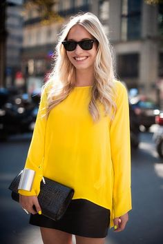 Black mini skirt with yellow blouse and purse