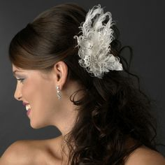 The Ivory Silver Clear Bridal Clip is a stunning cluster of feathers, and crystals.   Kim's Bridal,  Keywords:   #michiganbridalshop #weddingaccessories #kimsbridal Follow Us: http://www.kimsgiftbaskets.com/ ... https://www.facebook.com/KimsGifts