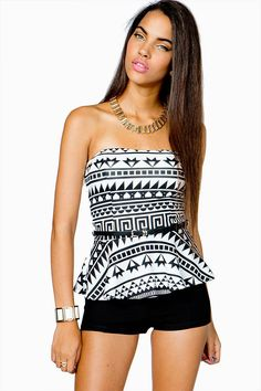 Take classic black and white to the next level. A strapless peplum top with a black and white tribal printed body. Sweetheart neckline. Built-in bra. Skinny belt included.