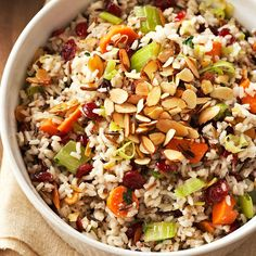 Rice replaces bread in this cranberry, almond, and vegetable-paced Wild Rice Dressing. More holiday recipes: www.bhg.com/thanksgiving/recipes/7-make-ahead-stuffing-recipes/?socsrc=bhgpin101812wildricedressing#page=2