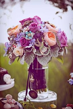 Gorgeous vintage bridal bouquet.  I love the hues of purple and the floral choices.