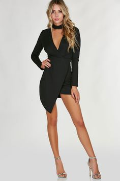 Chic choker neck dress with cut out in front. Long sleeves with envelope hem and back zip closure.