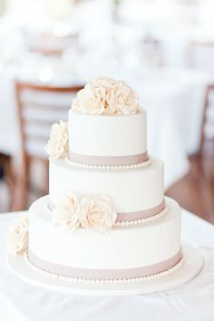 Wedding Cake: like the ribbon and little beaded edge, but different flowers