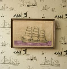 wallpaper for a boy's room, accented with colorful fabrics that maintain the sailing theme: shades of blue, green and white. Being me, I'd have to throw in some red somewhere....