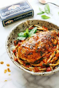 Garlic Basil Chicken with Tomato Butter Sauce - this real food recipe only requires 7 simple ingredients: chicken, pasta, garlic, olive oil, tomatoes, basil, butter. SO good!!