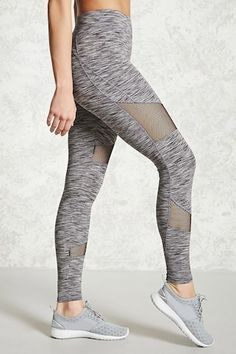 An athletic pair of stretch knit leggings featuring a space dye pattern, open-knit mesh paneling on the front, an elasticized waistband with a hidden key pocket, and moisture management.