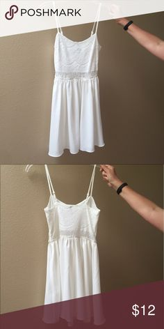 White short dress Top has a lovely Lacey design to it while the bottom half is plain. Has a easy side zipper that is used to get in and out of the dress. Middle of dress is just lace and is see through, very cute! Good for summer. H&M Dresses Mini