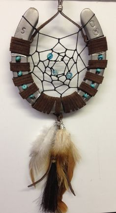My first horseshoe dream catcher!  Made with leather, black sinew, horsehair, feathers, wire, turquoise beads, silver beads and glow in the dark beads.   Sweet dreams for my beautiful daughter, Lynn. Thank you for the inspiration and motivation.