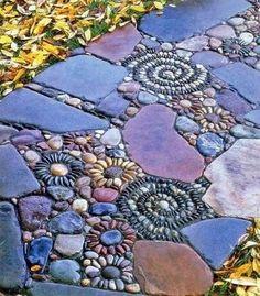 diy pebble mosaic pathway - http://everythingorganized.org/diy-pebble-mosaic-pathways/