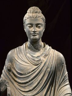 Early sculpture of standing philosopher Buddha from ancient Gandhara (Pakistan/Afghanistan)