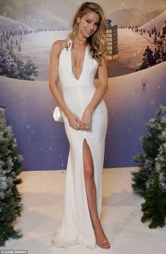 Star of the show: Jennifer Hawkins dazzled in a plunging white gown at the Myer Supplier of the Year Awards on Friday