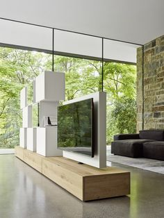 This multimedia unit by Studio IQ creates a divide between two rooms with a rotating TV stand, perfect for use in both spaces. Available from IQ Furniture.