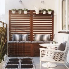 Ikea Outdoor Patio Furniture A Balcony With Brown Wooden Storage Benches With Seat Cushions, Wall Panels And Shelves Filled Ikea Outdoor, Small Outdoor Spaces, Outdoor Storage, Ikea Garden Storage, Outdoor Decking, Outdoor Benches, Ikea Storage, Outdoor Flooring, Ikea Garden Furniture