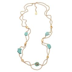 Stone and gold nuggets are suspended from double stranded gold chain in a flowing long gold and turquoise necklace. Wear long or double around your neck for two versatile looks.