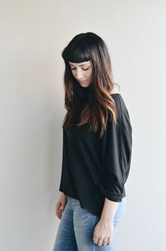 THE T TOP in Black ...It's simple, easy, and a perfect layering piece  under your T Sweater. Made from Raw Silk, the lightweight, textured fabric  makes seasonal transitions easy and washes to perfection.  Don't fuss with this piece... Just throw her on and be gone!  The more you wash Raw Si