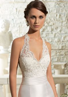 Dreamy lace and Satin perfectly compliment this sheath Bridal Dress. Featuring a…