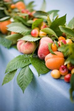 Peaches and apricots tucked into centerpieces, piled in little dishes
